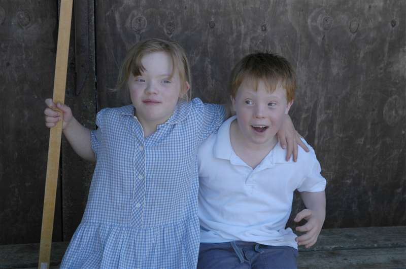 A photograph of children with Down syndrome at school