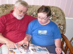 Declan and his father reading a book